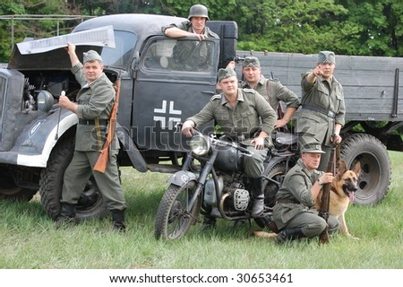 KIEV, UKRAINE - MAY 9: Members of a military history club wear historical German uniform as  they participate in a WWII reenactment May 9, 2009 in Kiev, Ukraine.