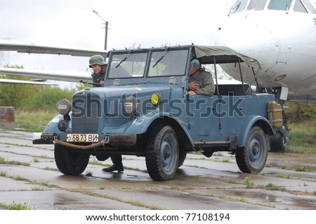 KIEV, UKRAINE - MAY 6 : Members of Red Star history club & German military jeep  during historical reenactment of WWII on May 6, 2011 in Kiev, Ukraine