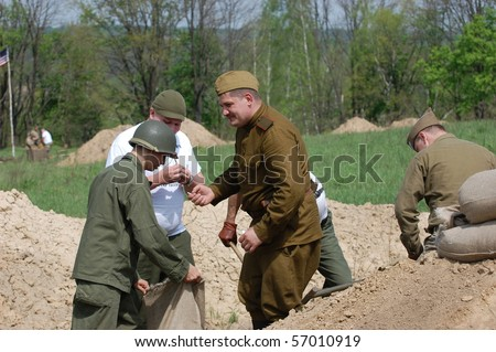 KIEV, UKRAINE - MAY 10 : members of Red Star history club wear historical American&Soviet uniforms during participation in 1945 WWII reenactment May 10, 2010 in Kiev, Ukraine