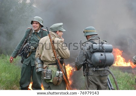 KIEV, UKRAINE - MAY 6 : Members of Red Star history club wear historical German uniform during historical reenactment of WWII on May 6, 2011 in Kiev, Ukraine