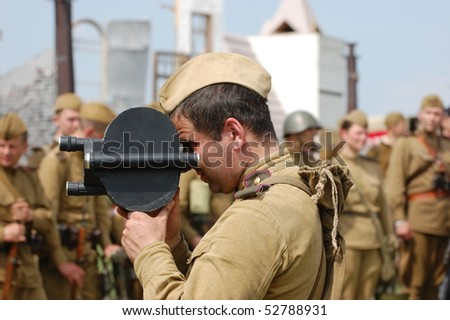 KIEV, UKRAINE - MAY 10 : Members of Red Star history club wear historical Soviet uniform during historical reenactment of 1945 WWII, May 10, 2010 in Kiev, Ukraine. - stock photo