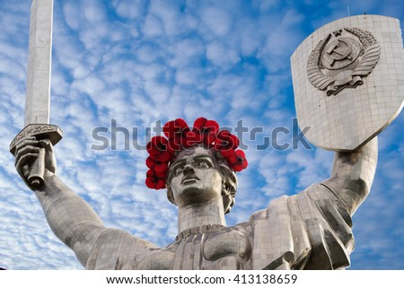 KIEV UKRAINE - MAY 9, 2015: Mother Motherland statue decorated with red poppy flower wreath on Victory Day in Kiev, Ukraine - stock photo