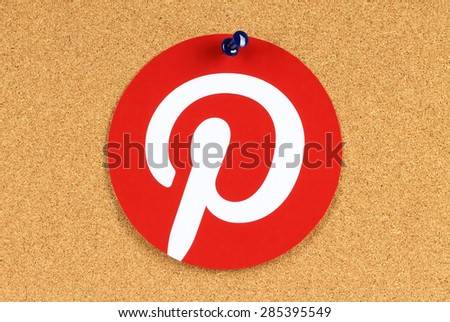 KIEV, UKRAINE - MAY 25, 2015:Pinterest logotype printed on paper and pinned on cork bulletin board. Pinterest is photo sharing website. - stock photo
