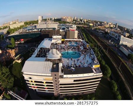 Kiev, Ukraine, May 10, 2015. Pool party on the roof, the grand opening of the Beach Club, aerial view - stock photo