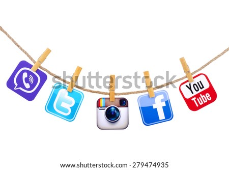 KIEV, UKRAINE - MAY 19, 2015: Popular social media Facebook, instagram, Viber, Twitter, YouTube hanging on the clothesline isolated on white background. - stock photo