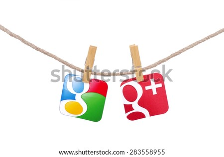 KIEV, UKRAINE - MAY 19, 2015: Popular social media Google  and  Google plus  hanging on the clothesline isolated on white background. - stock photo