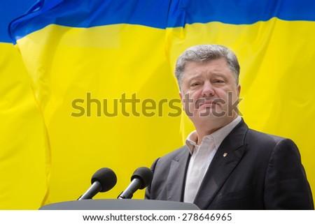 "KIEV, UKRAINE - May. 17, 2015: President of Ukraine Petro Poroshenko speaks on Remembrance Day of Victims of Political Repression in the National Historical Memorial Reserve ""Bykivnia Graves"" - stock photo"