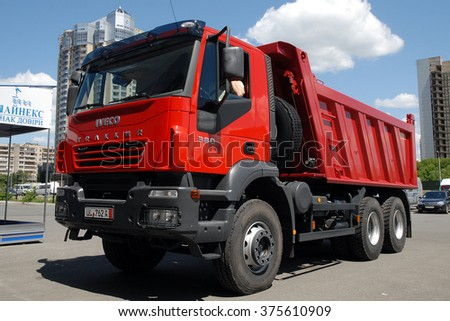 Kiev, Ukraine - May 26,  2009. Red dump truck Iveco Trakker. - stock photo