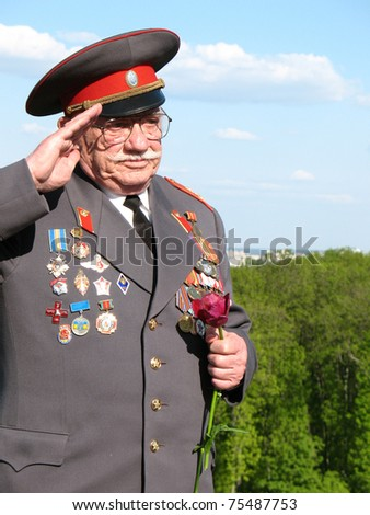 KIEV, UKRAINE - MAY 9: Soviet Army veteran of World War II at victory parade in Kiev, Ukraine, May 9, 2008 - stock photo