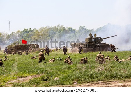 KIEV, UKRAINE - MAY 11, 2013 :Unidentified member of Red Star history club wear historical Soviet uniform during historical reenactment of WWII - stock photo