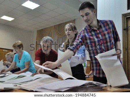 KIEV, UKRAINE � 25 MAY 2014: Unknown people count voices on president and local election on 25 May 2014 in Kiev, Ukraine.