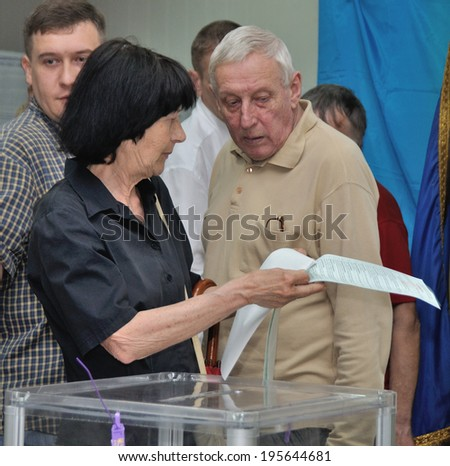 KIEV, UKRAINE - 25 MAY 2014: Unknown people vote on the president and local election on 25 May 2014 in Kiev, Ukraine