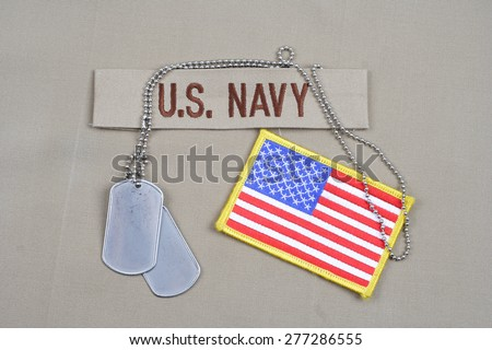 KIEV, UKRAINE - May 9, 2015. US NAVY branch tape with dog tags on uniform background