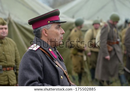 KIEV, UKRAINE -NOV 2: An unidentified member of Red Star history club wears historical Soviet uniform during historical reenactment of WWII, Dnepr river crossing 1943, November 2, 2013 Kiev, Ukraine