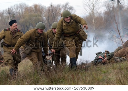 KIEV, UKRAINE -NOV 3 An unidentified members of Red Star history club wear historical Soviet uniform during historical reenactment of WWII, Battle for Kiev 1943 on November 3, 2013 in Kiev, Ukraine - stock photo
