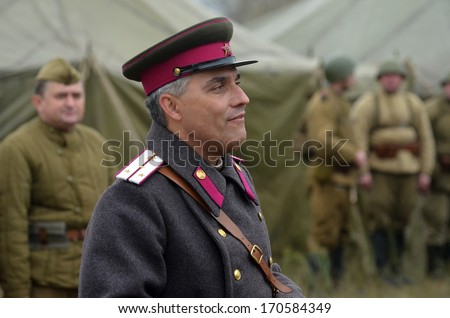 KIEV, UKRAINE -NOV 2: An unidentified members of Red Star history club wear historical Soviet uniform during historical reenactment of WWII, Dnepr river crossing 1943, November 2, 2013 Kiev, Ukraine