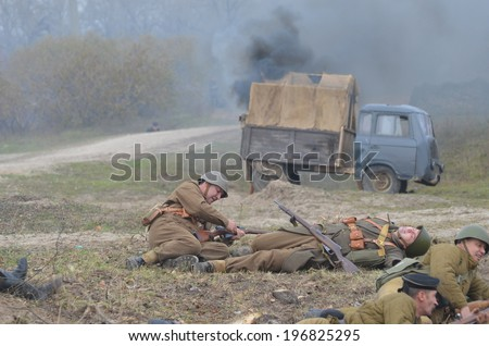 KIEV, UKRAINE -NOV 3: An unidentified members of Red Star history club wear historical Soviet uniform during historical reenactment of WWII, Battle for Kiev 1943 on November 3, 2013 in Kiev, Ukraine  - stock photo