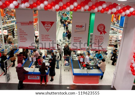 KIEV, UKRAINE - NOV 19: Customers pay at the cash register at the opening of the largest mall in Ukraine - OCEAN PLAZA on November 19, 2012 in Kiev. OCEAN PLAZA has 120 690 sq.m. & 1800 parking places - stock photo