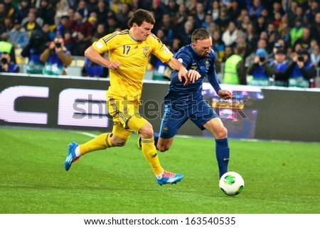 KIEV, UKRAINE - NOV 15: Fedetskiy (L) against Franck Ribery (R) during the play-off match for the 2014 World Cup between Ukraine vs France, 15 November 2013, NSC Olympic Stadium, Kiev, Ukraine