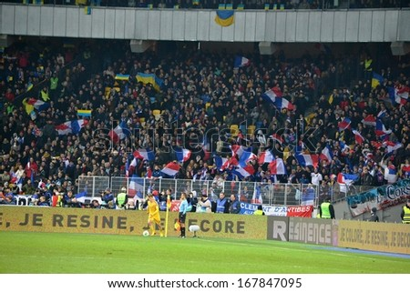 KIEV, UKRAINE - NOV 15: French football fans in the stands during the play-off match for the 2014 World Cup between Ukraine vs France, 15 November 2013, NSC Olympic Stadium, Kiev, Ukraine