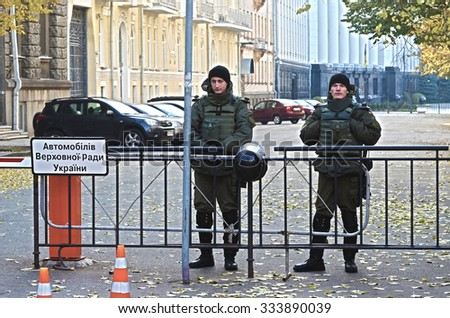 KIEV , UKRAINE - NOV 1, 2015. Nazional Guard soldiers secure block of  Government buildings during protests of Gay Party of Ukraine . November 1, 2015 in Kiev, Ukraine - stock photo