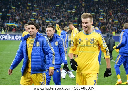 KIEV, UKRAINE - NOV 15: Ukrainian players celebrate victory after the play-off match for the 2014 World Cup between Ukraine vs France, 15 November 2013, NSC Olympic Stadium, Kiev, Ukraine