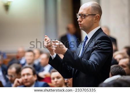 KIEV, UKRAINE - NOV 27, 2014: Ukrainian Prime Minister Arseniy Yatsenyuk at the opening of the first session of the Verkhovna Rada of Ukraine VIII convocation - stock photo