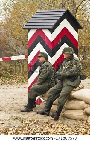 KIEV, UKRAINE -NOV 3: unidentified members of Red Star history club wear historical Soviet uniform during historical reenactment of WWII, Dnepr river crossing 1943, November 3, 2013 Kiev, Ukraine - stock photo