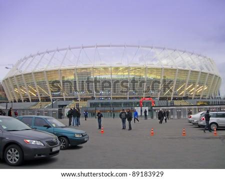 KIEV, UKRAINE -  NOVEMBER 11: Football attendees arrive at the Olympic National Sports Complex (AKA  Olympic Stadium, Central Stadium) for Euro 2012 football match between the Ukrainian and German teams on November 11, 2011 in Kiev, Ukraine. - stock photo