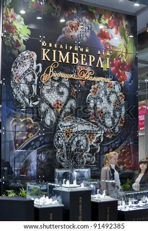 KIEV, UKRAINE - NOVEMBER 17: Presenters of Kimberli Jeweller House located in Vinnitsa booth during Autumn Jeweller Expo at KyivExpoPlaza Exhibition Center on November 17, 2011 in Kiev, Ukraine. - stock photo