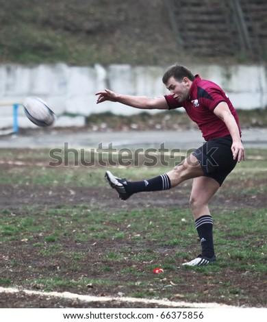 KIEV, UKRAINE - NOVEMBER 20 : Rugby players in action at a Ukrainian National Championship rugby match, Antares(in black) vs. Eger(in red), November 20, 2010 in Kiev, Ukraine. - stock photo
