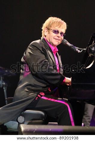 KIEV, UKRAINE - NOVEMBER 8: Singer Elton John performs onstage at Sport Palace on November 8, 2011 in Kiev, Ukraine - stock photo