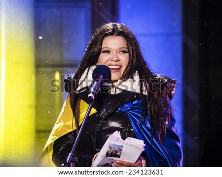 "KIEV, UKRAINE - November 29, 2014: Social activist and winner of Eurovision singer Ruslana. -- At the Independence Square in Kiev, an action called ""The Night of memory""  - stock photo"