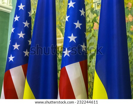 KIEV, UKRAINE - November 21, 2014: US and Ukranian flags -- US Vice President Joe Biden announced in Kiev to increase military aid to Ukraine in its conflict with Russia.  - stock photo
