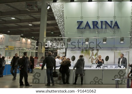 KIEV, UKRAINE - NOVEMBER 17: Visitors visit Jeweller House ZARINA booth during Autumn Jeweller Expo exhibition at KyivExpoPlaza Exhibition Center on November 17, 2011 in Kiev, Ukraine. - stock photo
