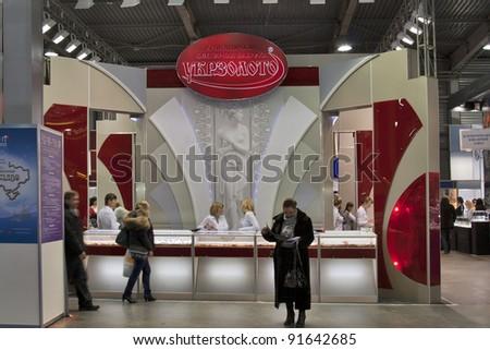 KIEV, UKRAINE - NOVEMBER 17: Visitors visit UKRZOLOTO (UkrGold) Jewelry company booth during Autumn Jeweler Expo exhibition at KyivExpoPlaza Exhibition Center on November 17, 2011 in Kiev, Ukraine. - stock photo