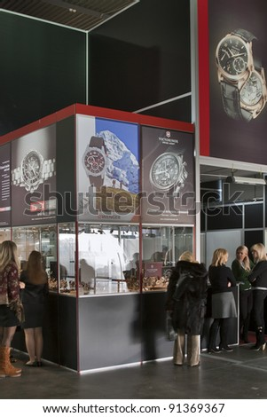 KIEV, UKRAINE - NOVEMBER 17: Visitors visit Victorinox, Timex and Wenger watches booth at Autumn Jeweller Expo at KyivExpoPlaza Exhibition Center on November 17, 2011 in Kiev, Ukraine. - stock photo