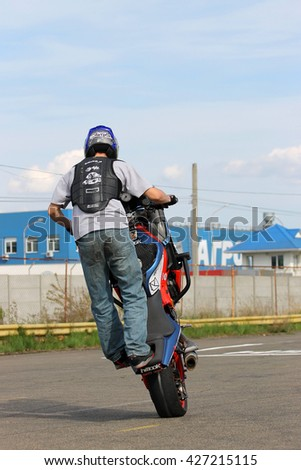 Kiev, Ukraine - Now 22: Motorcyclist perform stunts on a motorcycle. Extreme riding, on Now 22, 2015 in Kiev, Ukraine