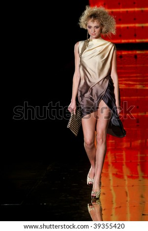 "KIEV, UKRAINE - OCT 15: Model poses at the runway during Fashion Show by ""GROMOVA DESIGN"" as part of Ukrainian Fashion Week, October 15, 2009 in Kiev, Ukraine."