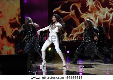 "KIEV, UKRAINE - OCT. 23: Winner Eurovision singer Ruslana arrives at the opening , at the Opera Theatre 40th Film Festival ""Molodist"" on October 23, 2010 in Kiev, Ukraine - stock photo"