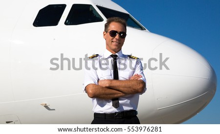 Kiev, Ukraine - OCTOBER 10, 2014: Airline pilot standing near aircraft.