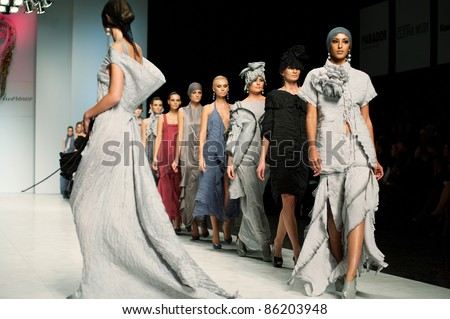 "KIEV, UKRAINE - OCTOBER 19: Fashion model wears clothes created by ""Katya PSHECHENKO"" at the 24th Ukrainian Fashion Week on Oct. 19, 2009 in Kiev, Ukraine. - stock photo"