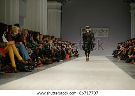 "KIEV, UKRAINE - OCTOBER 14: Fashion model wears clothes created by ""Tetyana ZEMSKOVA & Olena VOROJBIT"" at the Ukrainian Fashion Week on Oct. 14, 2011 in Kiev, Ukraine. - stock photo"