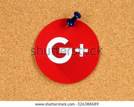 Kiev, Ukraine - October 07, 2015: New Google Plus logo sign printed on paper, cut and pinned on cork bulletin board. Google is USA multinational corporation. - stock photo