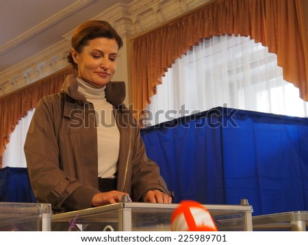 KIEV, UKRAINE - October 26, 2014: Voted wife of President of Ukraine Poroshenko Marina. She reported that her husband controls the voting  in the area of anti-terrorism operations in the Donbass.  - stock photo