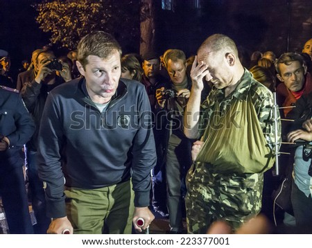 KIEV , UKRAINE - October 13, 2014: Wounded soldiers volunteer battalion Aydar consider National Guardsmen deserters.About 500 National Guard conscripts picketed Presidential Administration of Ukraine