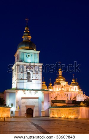 Kiev Ukraine Saint Michael church belfry gate, domes and entrance night view - stock photo