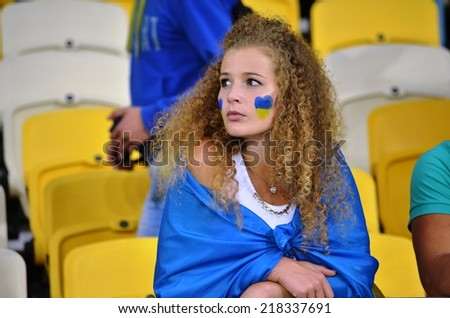 KIEV, UKRAINE - SEP 8: Fans of Ukraine and the girls in the stands during the match Ukraine 0-1 Slovakia UEFA Euro 2016 qualifier match, 8 September 2014, Kiev, Ukraine