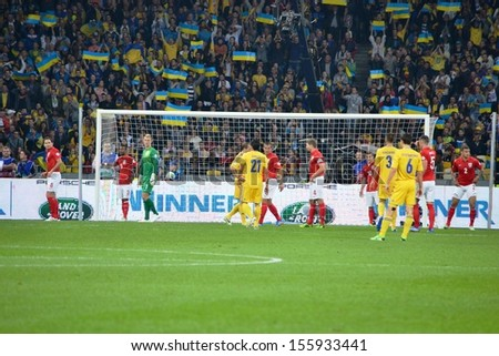 KIEV, UKRAINE - SEP 10: Football team of Ukraine and England in action during the qualifying match 2014 World Cup between Ukraine vs England, 10 September 2013, NSC Olympic Stadium, Kiev, Ukraine