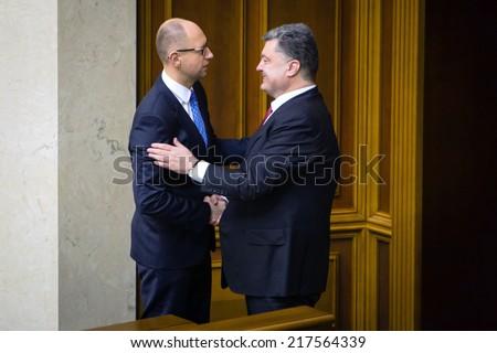 KIEV, UKRAINE - Sep 16, 2014: President of Ukraine Petro Poroshenko and Prime Minister Yatsenyuk after signing the law on ratification of the Association Agreement between Ukraine and the EU - stock photo